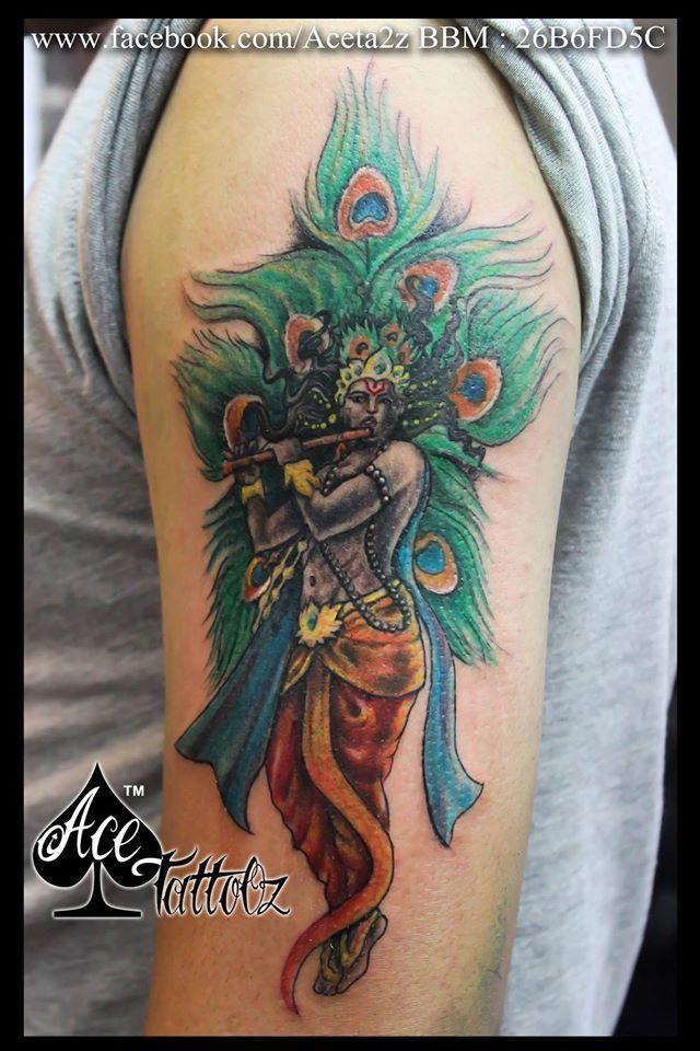 9e2e9b480 krishna tattoo with peacock feather#PeacockFeatherTattoo #LordKrishnaTattoo  #ColourKrishnaTattoo #KrishnaFeatherTattoo #StandingKrishnaTattoo ...