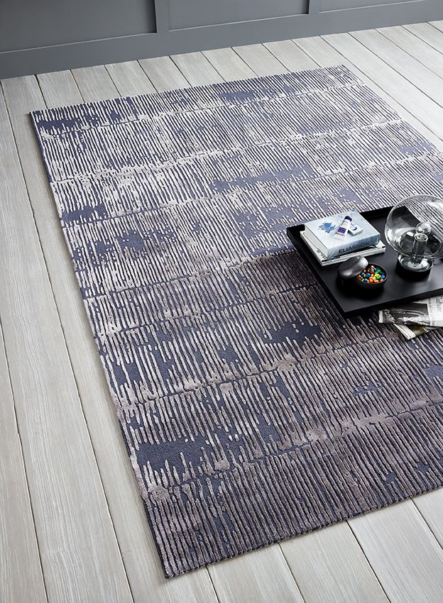 Assam Hand Tufted Rug With A Stripe Like Design In A