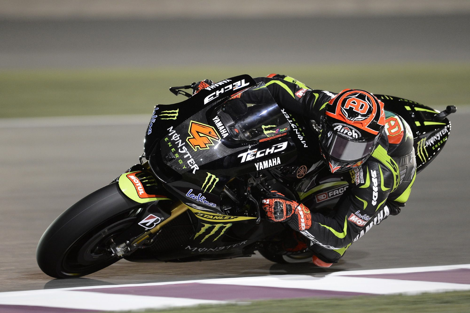 Doha, QAT - Andrea Dovizioso on his Monster Yamaha at Qatar, spent the first 16 laps fending off Monster Yamaha tech 3 team-mate Cal Crutchlow for fourth place, and top satellite rider, before the Englishman finally found a way past. #motogp