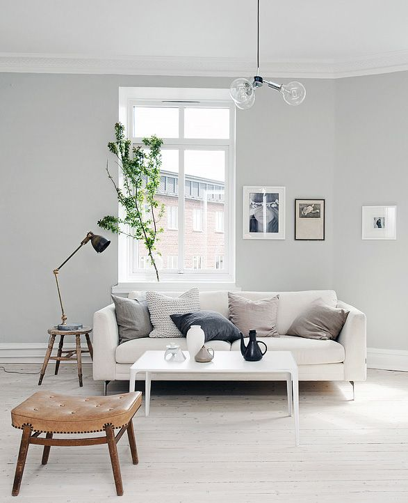 Light grey home with a mix of old and new via for Living room gray walls