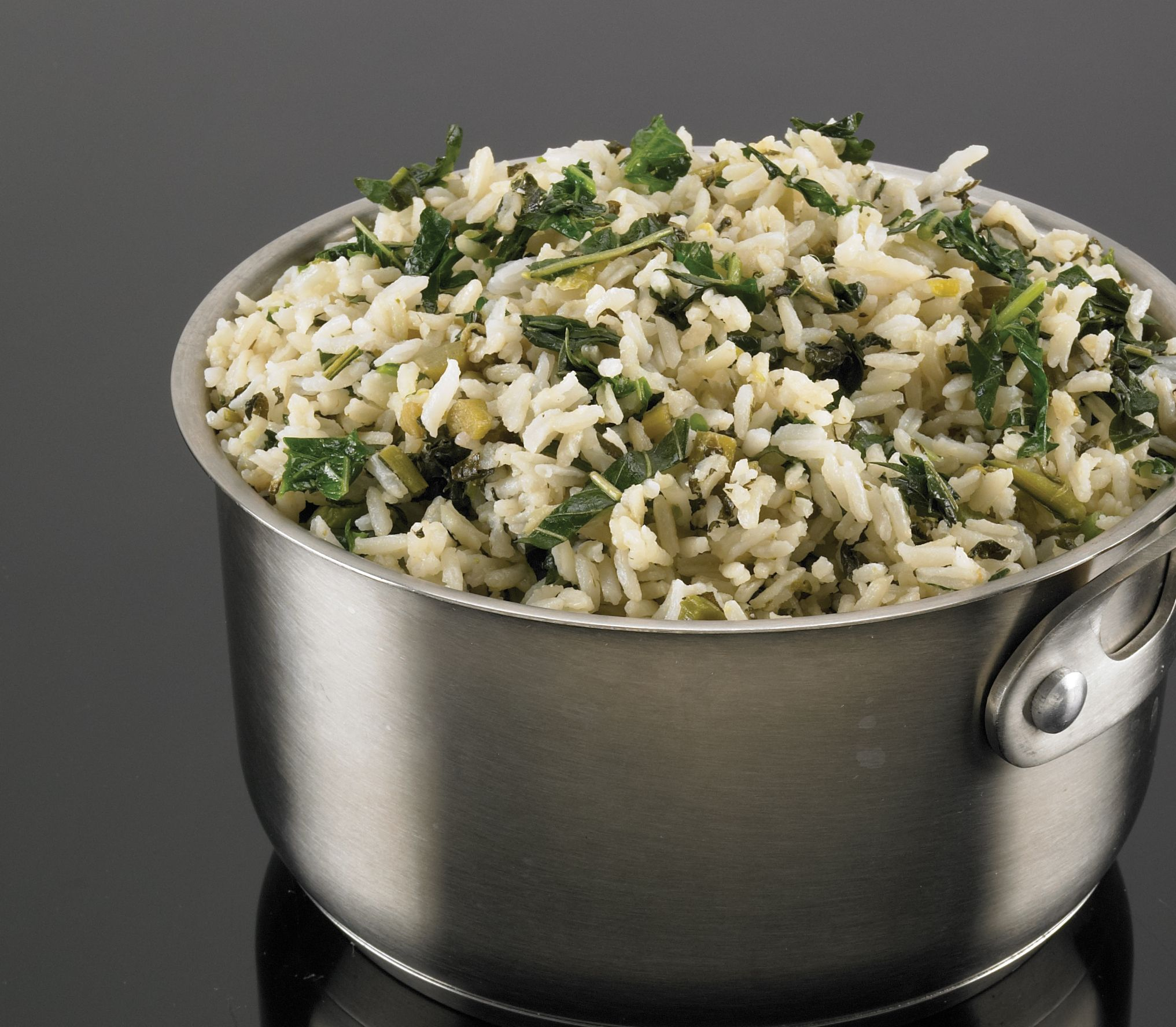 Rice steamed with callaloo and seasoned coconut milk. #seasonedricerecipes