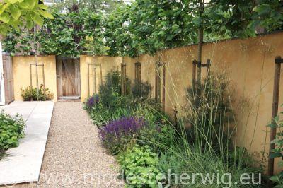 tuinen nederland mediterrane tuin muur border salvia nemorosa mainacht stipa gigantea. Black Bedroom Furniture Sets. Home Design Ideas