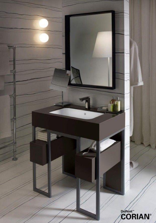 Lavabo Corian® Serenity instalado en un marco de acero y Corian® en ...