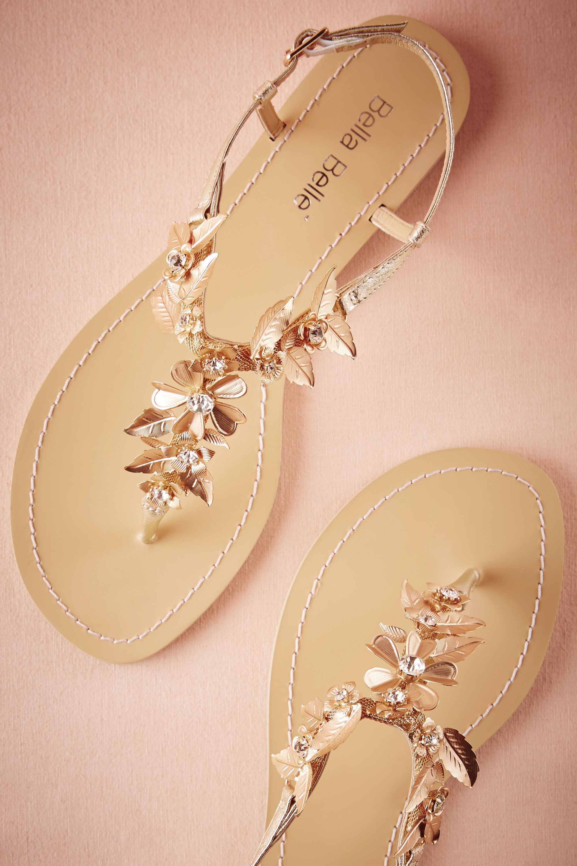 20e19d497cfdc Chrysanthe Sandals from  BHLDN. Grecian gold sandals for the boho brides.  Bohemian brass flowers accented with crystals.