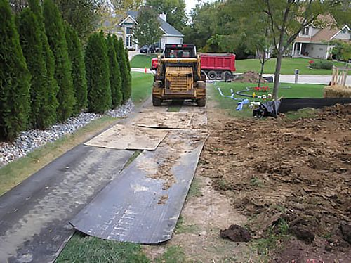 CONVEYOR BELT -- Have to do major yard work?  Prevent your yard from being torn up by heavy equipment--use conveyor belt yard mats!