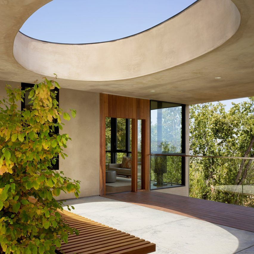 A large hole punctures the roof of this residence that
