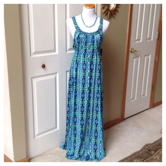 "Turquoise Multi Maxi Dress Turquoise/white/black/blue abstract print maxi Dress, elastic on the waist, 44"" long from under the bust to the bottom hem, braids detail straps; 100% polyester. The tag says size M (8/10) but it will fit a size Large (12). Dresses Maxi"