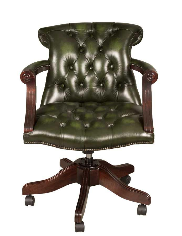 A sleek but traditional tufted leather desk arm chair in a ...