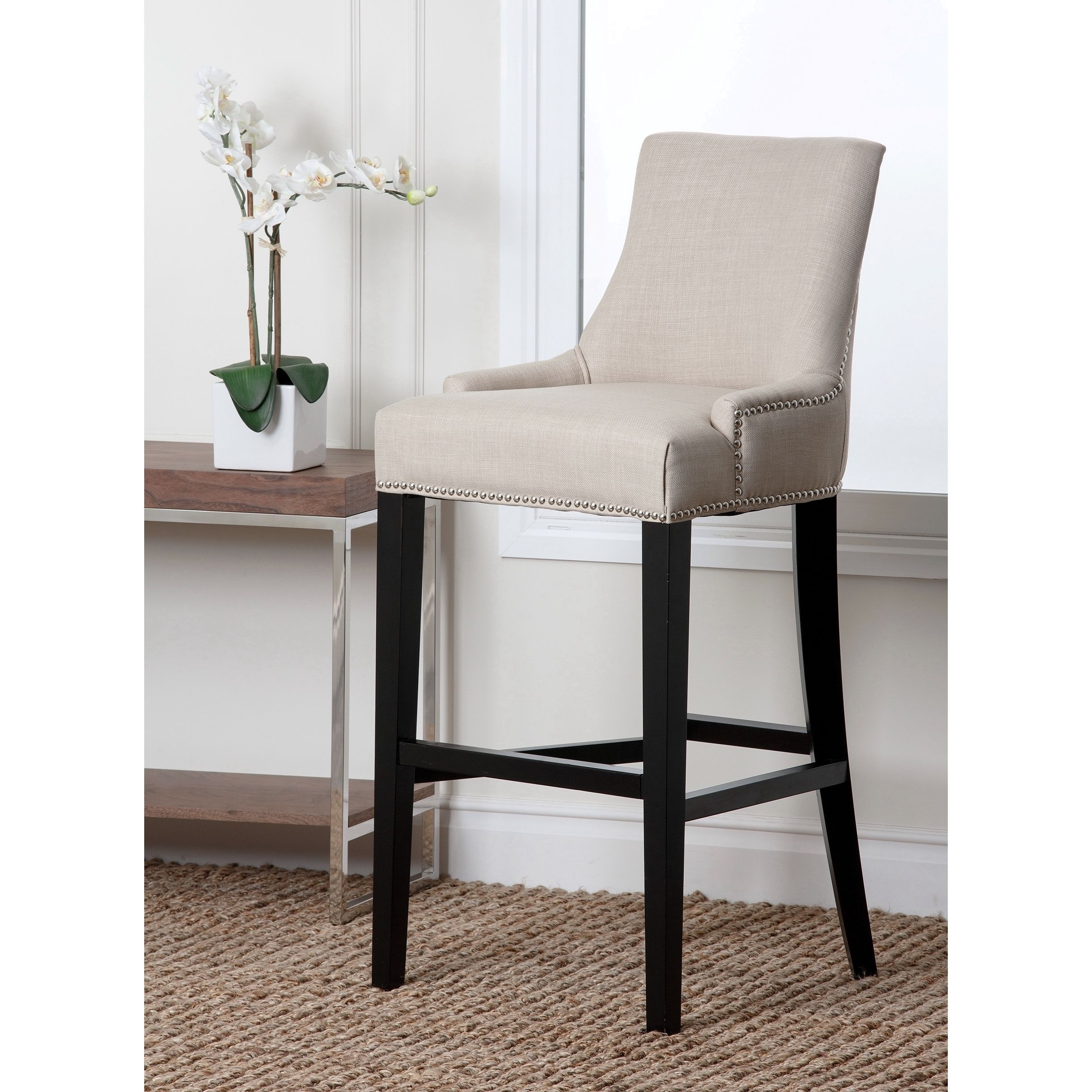 The Curved Arms And The Nailhead Trim Of This Bar Stool Present A Very  Comfortable,
