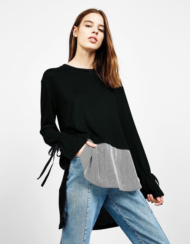 Langer Pullover mit gestreiftem Saum. Entdecken Sie diese und viele andere Kleidungsstücke in Bershka unter neue Produkte jede Woche