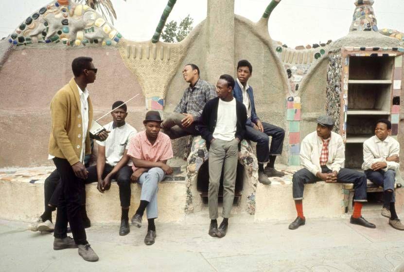 Young men hang out near Simon Rodia's Watts Towers, 1966.