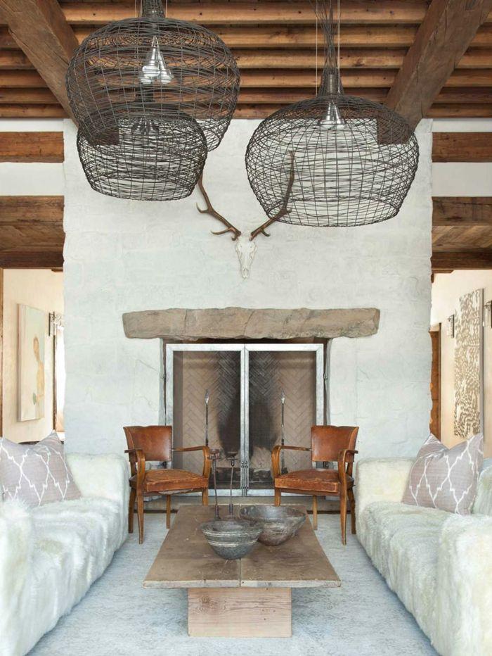 rustikales-Interieur-moderne-Möbel-Geweih-Kamin-Sofas-Stühle - designer mobel einrichtungsstil