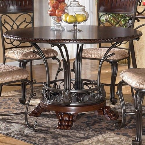 ashley furniture alyssa round single pedestal dining table with metal and wood base miskelly furniture - Metal Kitchen Table
