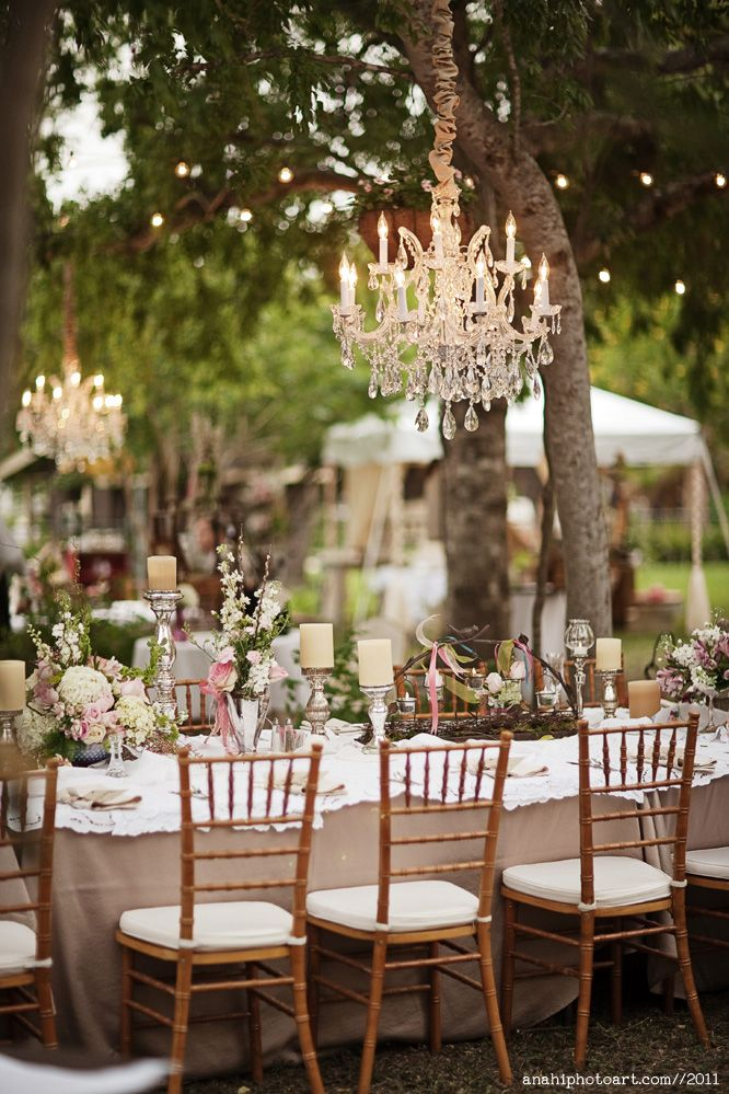 """chandeliers above the tables.  i also like the """"short"""" rectangular tables"""