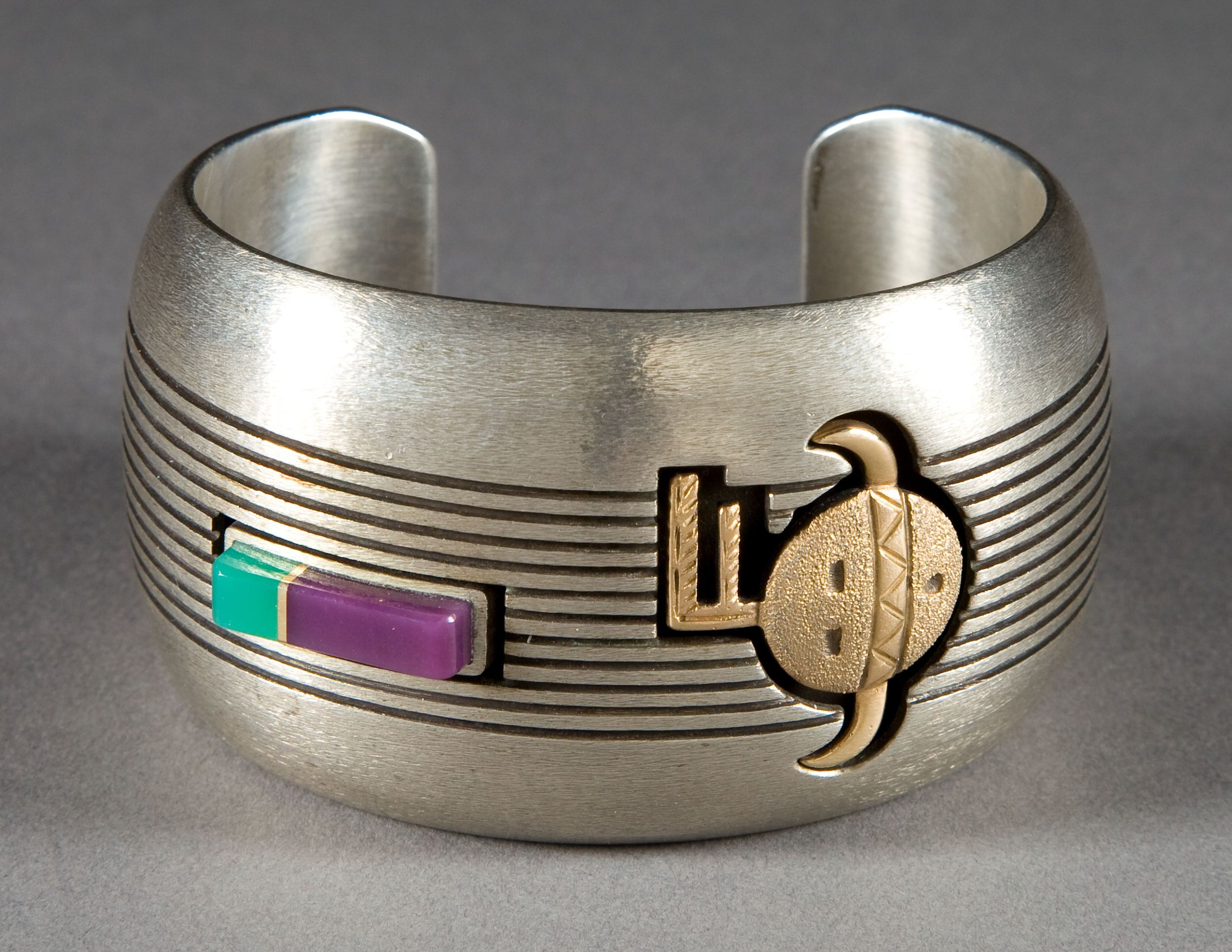 A NAVAJO SILVER, GOLD AND STONE CUFF BRACELET. James Little. | Lot #50023 | Heritage Auctions