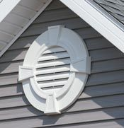 decorative gable vent above front bay window gable end