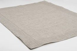 Light grey linen placemat with hemstitch.