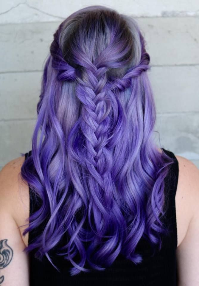 Purple hair color adorned with a braided hairstyle by ...