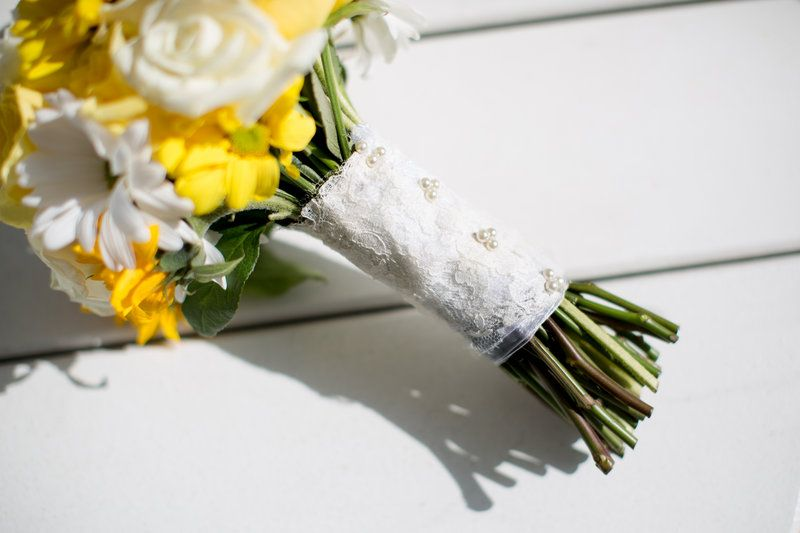 Lace wrapped bouquet with yellow and white flowers. Photo By Amanda ...