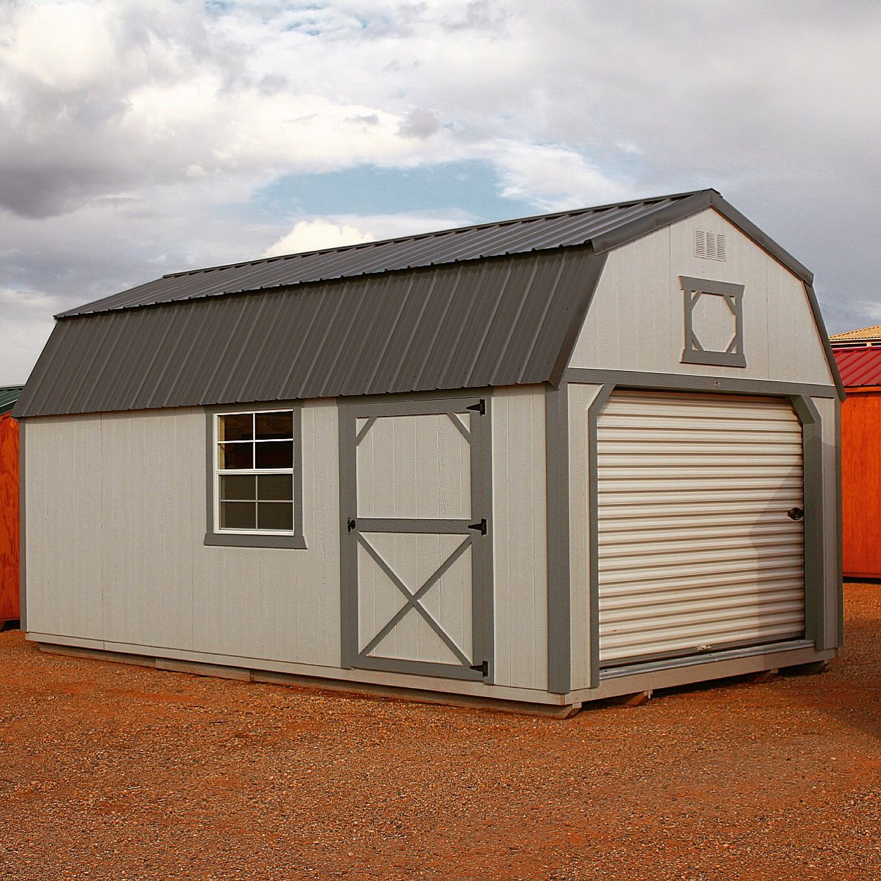 Painted lofted barn with a 6' roll up door. And a 64 ...