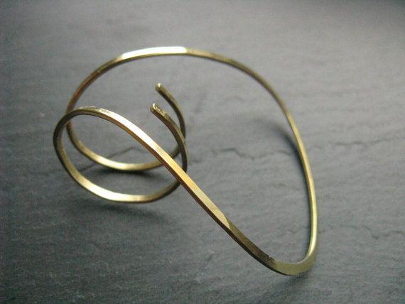 ring in golden brass , contemporary minimal