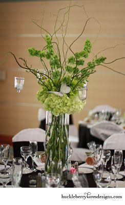 Tall green centerpiece, hydrangea, curly willow, bells of Ireland, hanging votives, green orchids