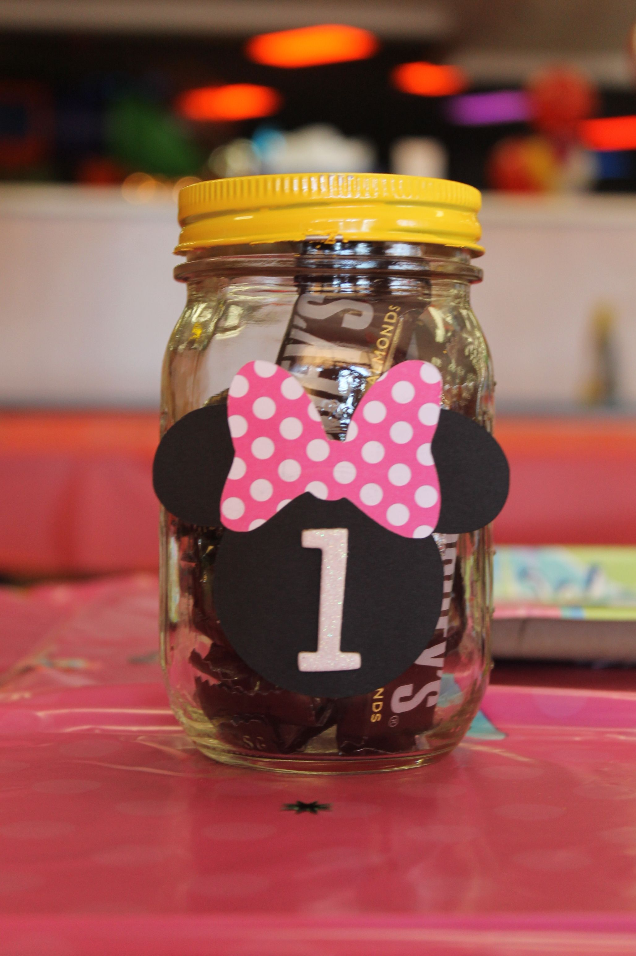 Mickey mouse centerpiece mason jar filled with candy