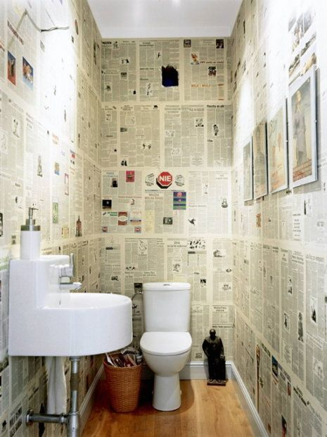 I have seen this used in pub toilets, its great idea cause if it gets drawn on you just cover it with another price of newpaper. awesome idea/