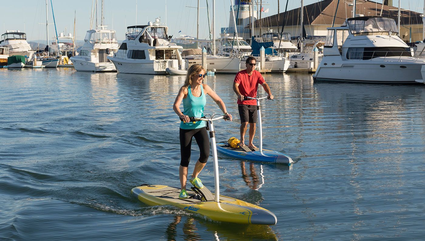 The Worlds First Stand Up Peddle Board Is Perfect To Have On A Sailboat Stand Up Pedal Board Hobie Mirage Paddle Boarding