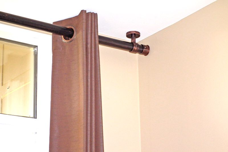 Superb Modern Living Room Design With Ceiling Mounted Curtain Rods, And Polished  Bronze Curtain Rods.