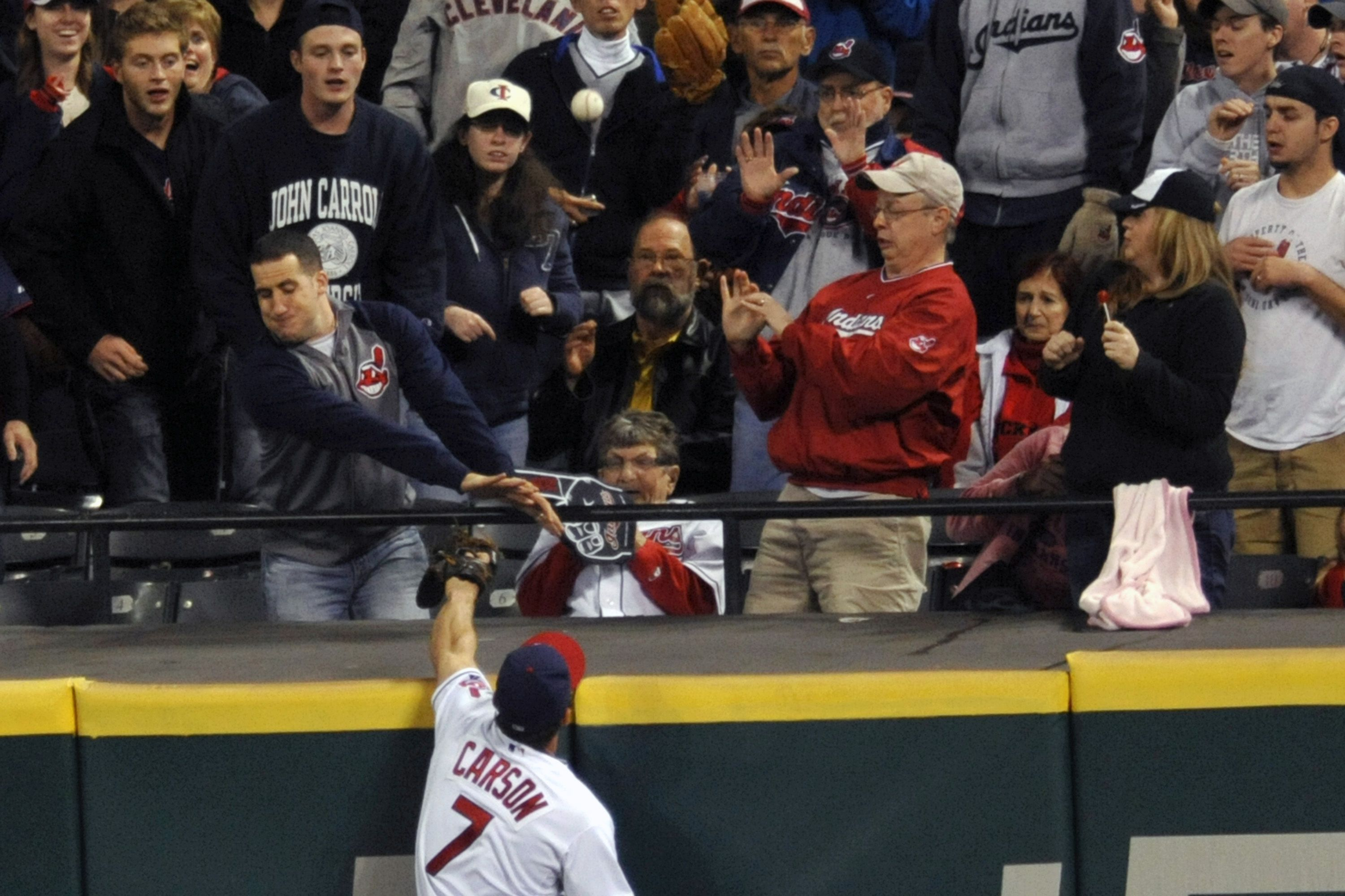 CrowdCam Hot Shot: Cleveland Indians right fielder Matt Carson reaches for a solo home run by Chicago White Sox center fielder Alejandro De Aza in the ninth inning at Progressive Field. Photo by David Richard