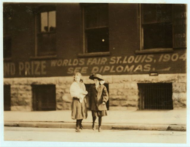 Young girls going home from Brown's Shoe Factory (Washington & 18th Sts.) at close of day.  Location: St. Louis, Missouri.