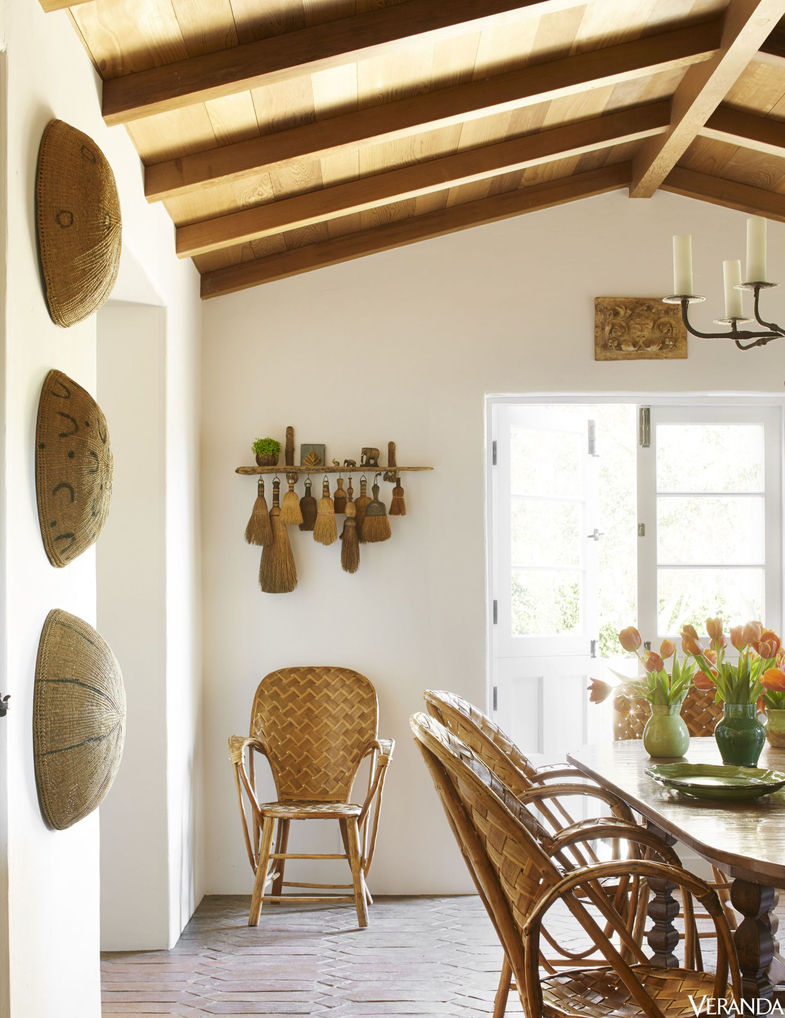 HOUSE TOUR Vintage French Rattan Chairs And Painted African Baskets In The Dining Room A Sun Kissed Retreat Inspired By Spanish History