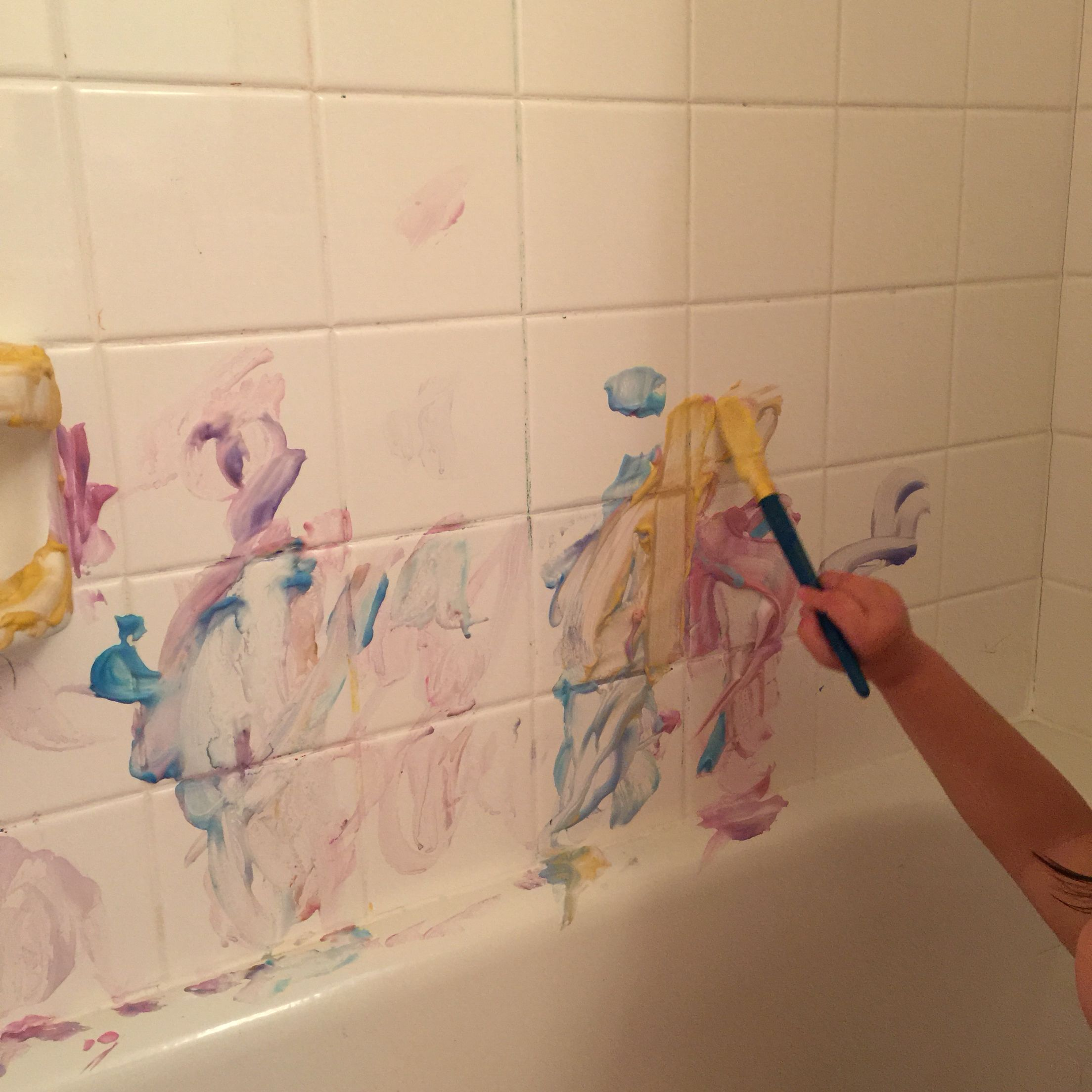"Shaving cream bath ""paint"". Fun for toddlers. All you need is shaving cream and food coloring."
