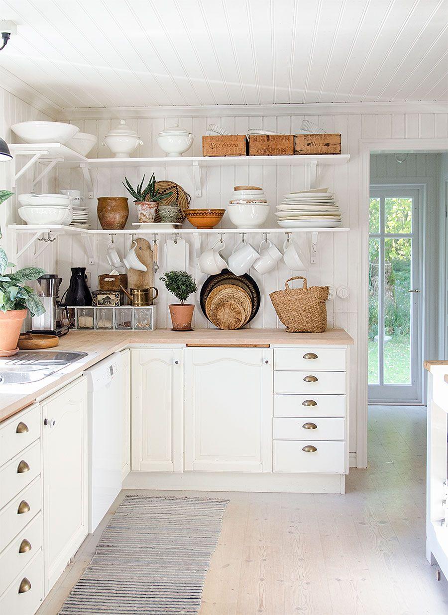 Modern Farmhouse Kitchen In Sweden Or Scandinavia White Beadboard Walls Cabinets With Bin