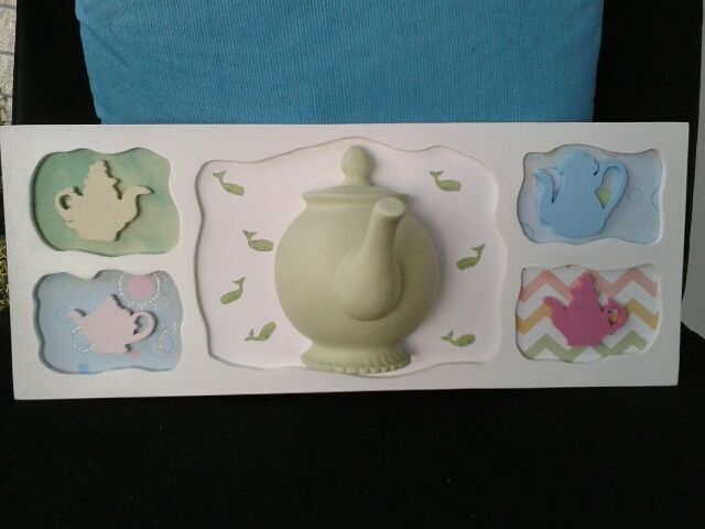 One of my teapot scroll saw projects.  Can be used to hang things on the spout.