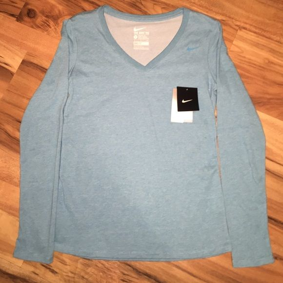 Nike V Neck tee Brand new never worn! Nike VNeck DriFit Cotton Long sleeve Tee! No rips or stains! Sorry I cut the tag for a gift but never gifted it! Nike Tops Tees - Long Sleeve