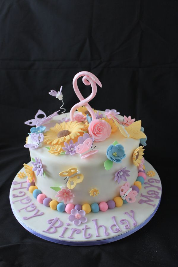 A flowers and butterflies themed birthday cake for an 8 year old.  Gumpaste decorations.