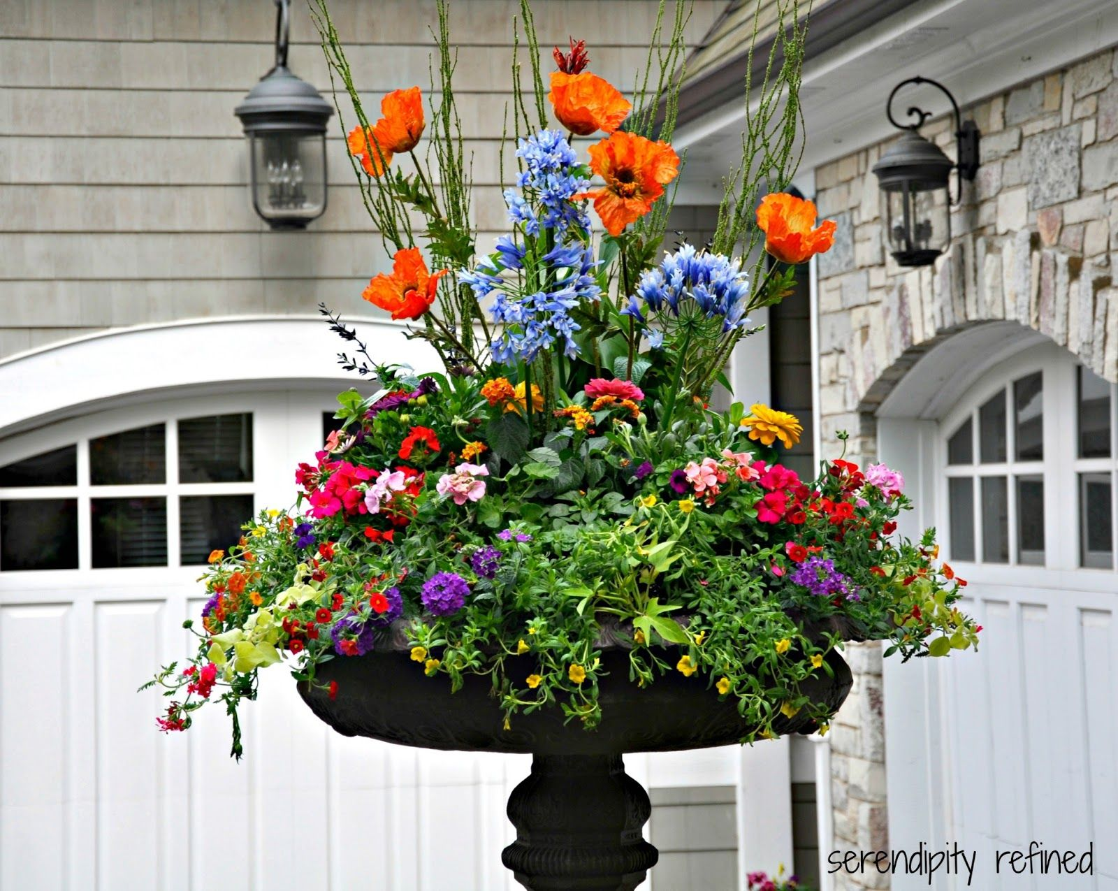 Spring Urn Planter Flower Arrangement With Forsythia Tulips Daffodils And  White Bird Houses. Description From