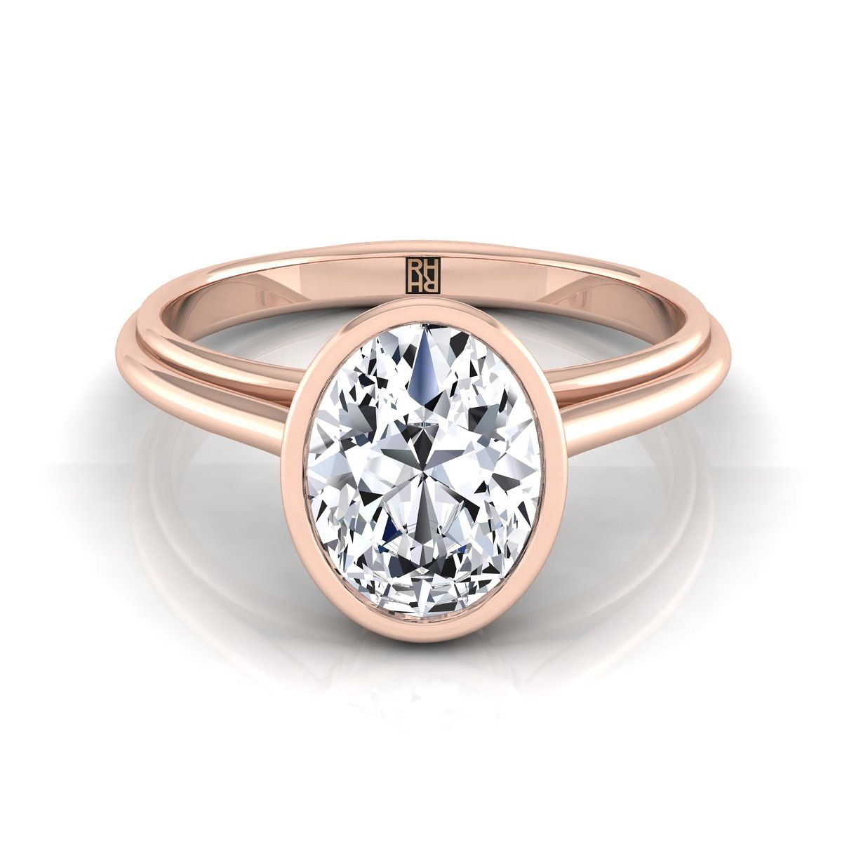 Oval diamond bezel solitaire engagement ring in k rose gold rose