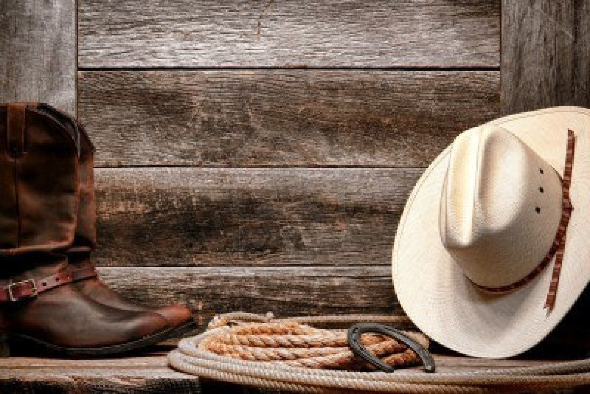 acbae74f68d26 ... West rodeo traditional white straw cowboy hat with authentic Western  lariat lasso and roper leather boots on distressed barn wood background Stock  Photo
