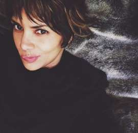 Halle Berry posted a pic of herself in a super sheer top, and the internet is losing it