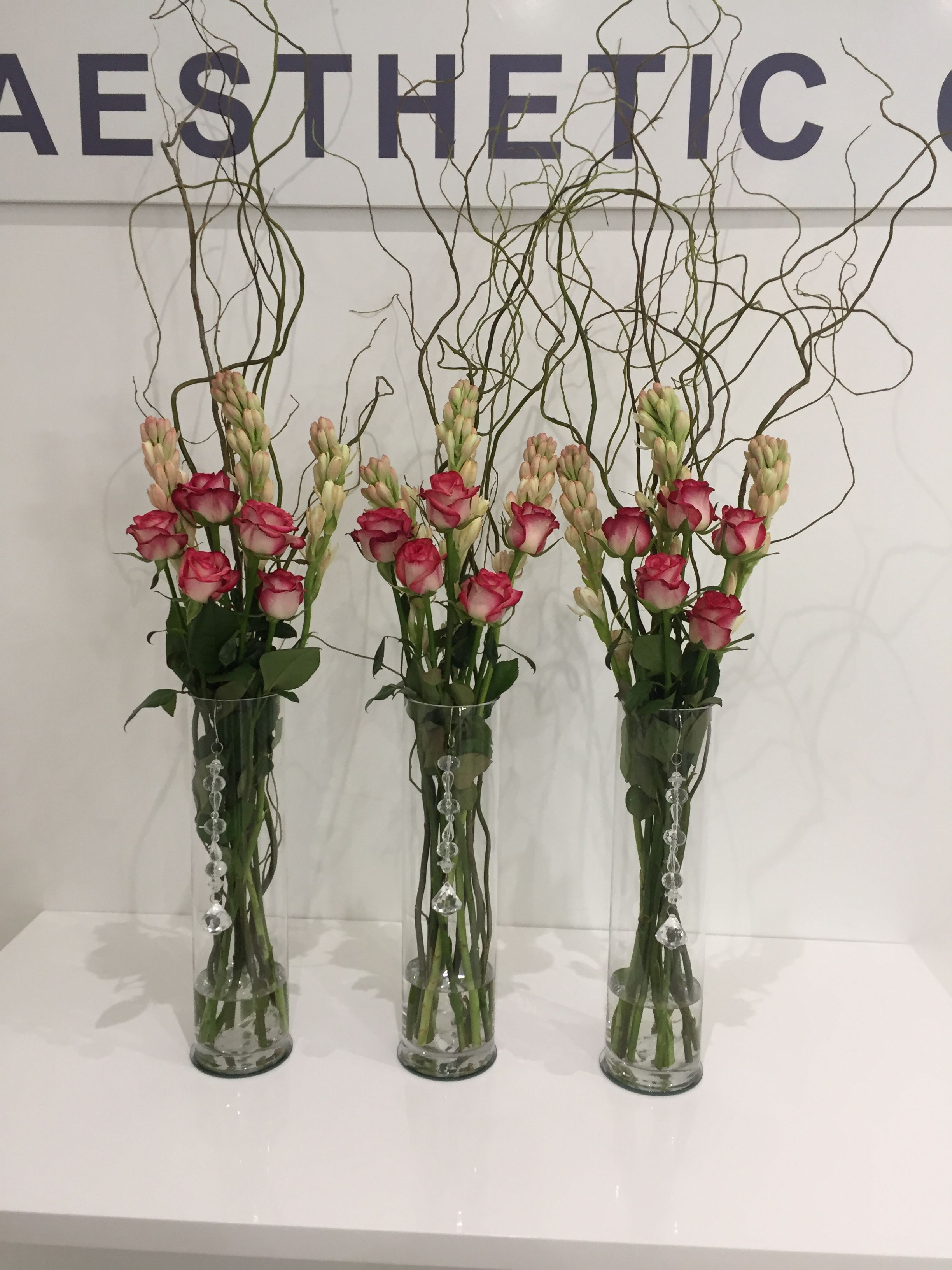 Pink Roses Tuberoses And Curly Willow Pink Roses Flower Arrangements Curly Willow