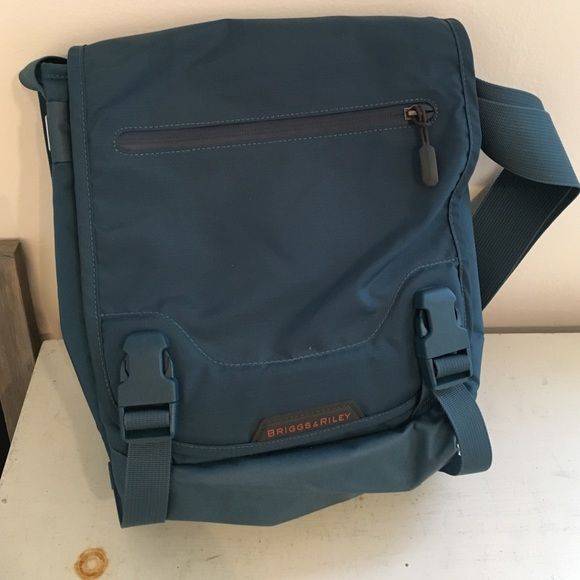 Briggs & Riley Messenger Bag Small nylon messenger bag. Padded compartment will fit an iPad. Organization on front panel. Brand new, never used. Briggs & Riley Bags