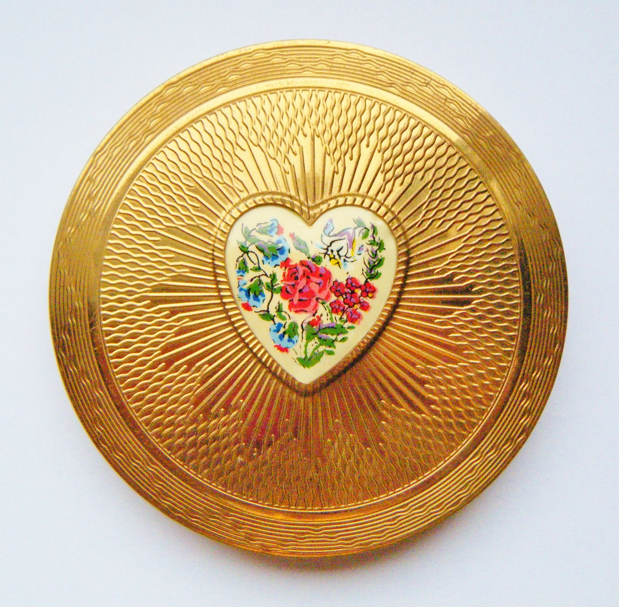 Heart Kigu Compact, £39.99 Compact shop, Lipstick case
