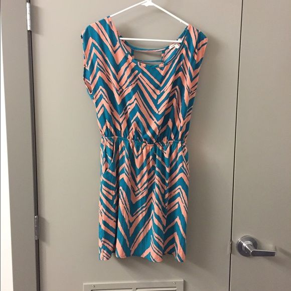 Dress. Turquoise and blush. Pockets. Somewhat open back. Worn twice. 100% polyester. Large but fits like a medium. Charlotte Russe Dresses Midi