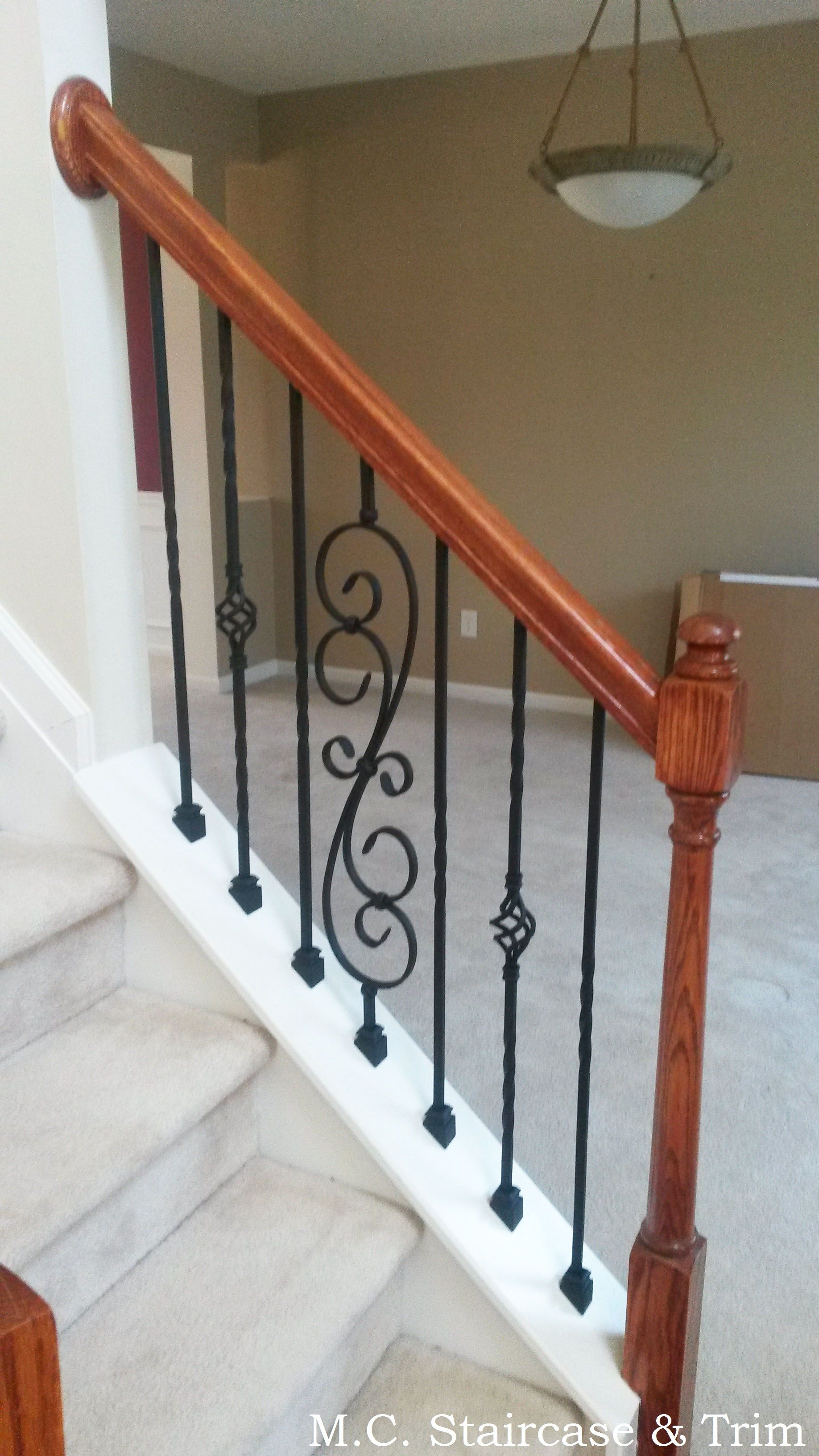 Iron baluster upgrade from M C Staircase & Trim Removal of wooden balusters and installation of alternating Twist Series Single Twist and Single Basket