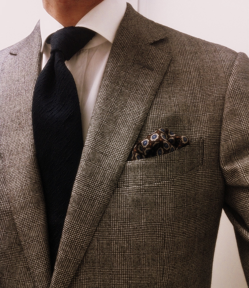 06438cb8bfbc Gray tweed jacket feat. a Prince of Wales Check: paired with textured black  tie, white shirt, and patterned pocket square