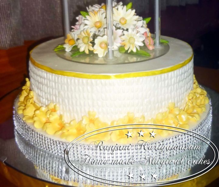 Two tier wedding cake design for a simple yellow-flower theme ... By ...