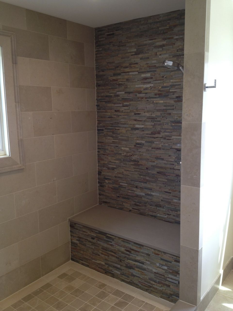 This Bathroom Features A Waterfall Earth Cleft Slate Accent Wall And Lagos Gold Limestone On The Bath Shower Floor